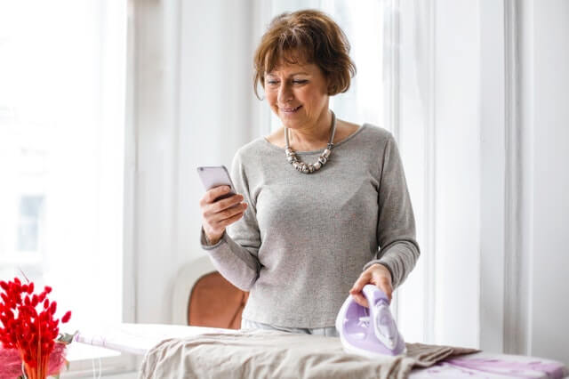 woman holding a phone to call for menopause medicine